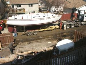 Boat lifted on trailer for trip to coast